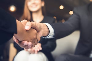 Successful Supplier Contract Agreement Handshake