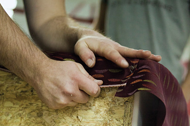 close-up of hands working with fabric