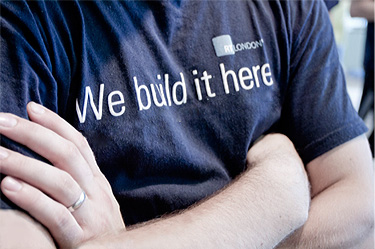 close-up of t-shirt that says we build it here