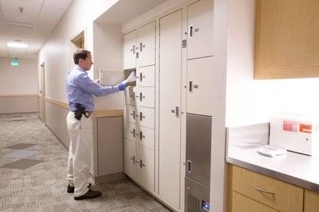 Man Unlocking Locker