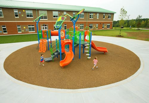 orange school playground on round brown surface
