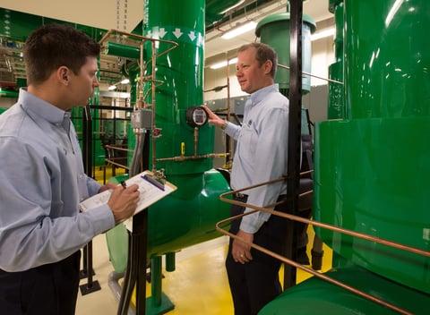 men working on a green machine