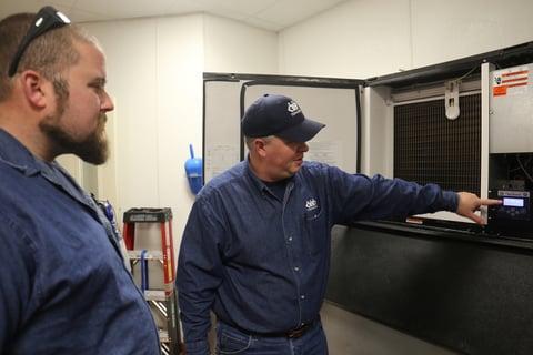 workers repairing a refrigerator