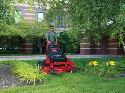 mowing grass near flowers