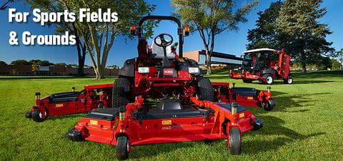 big maintenance lawnmower on a field
