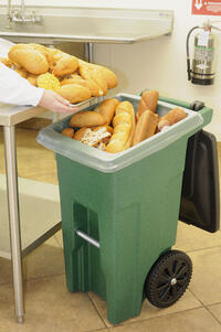 bread being dumped into a trash can
