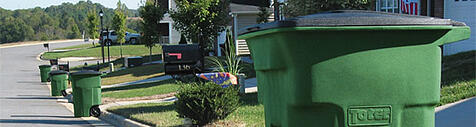 street view of garbage hoppers in front of houses