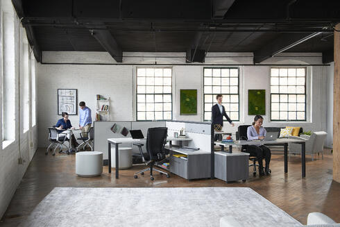 office interior with people working at modern desks