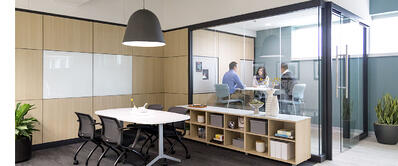 People having meeting in conference room with clear walls