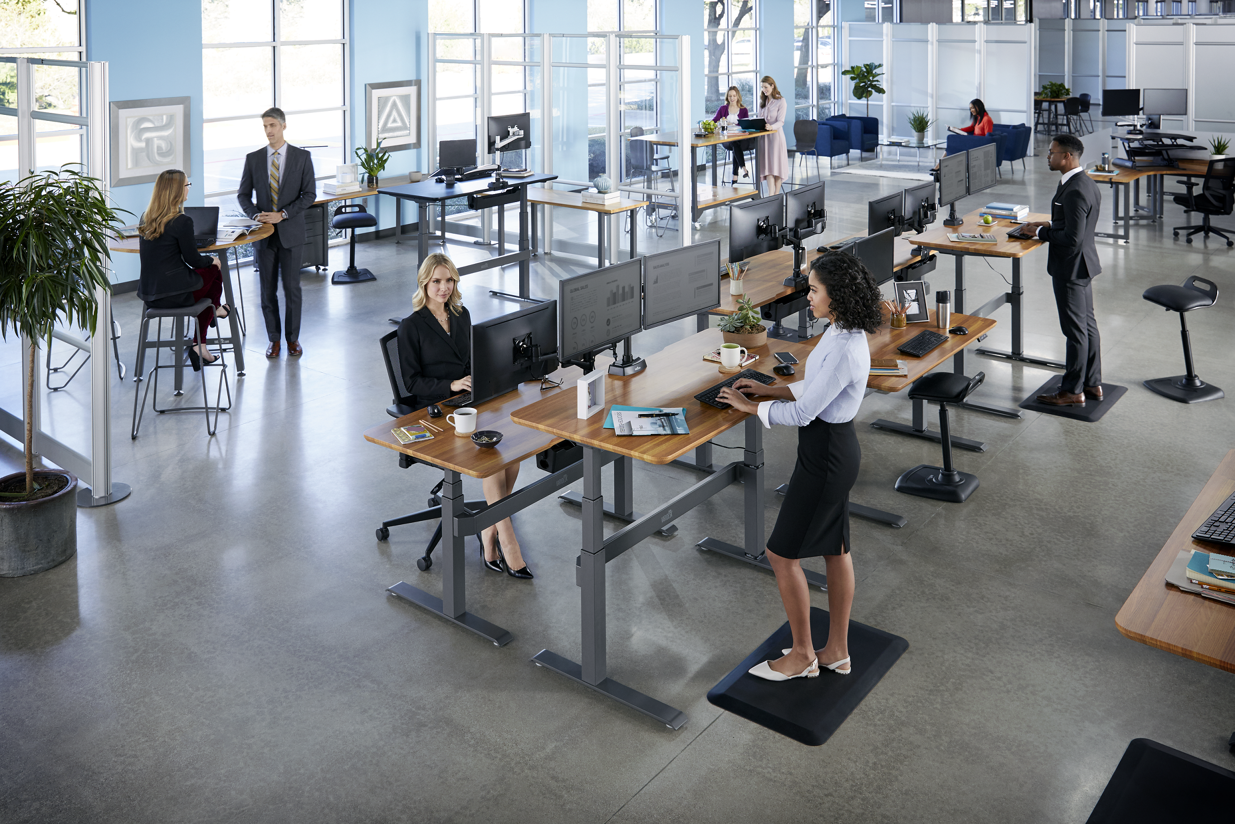 professional open office with people using standing desks