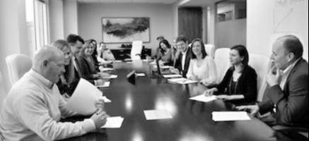 OMNIA Partners team members in a meeting