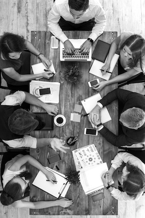 team collaborating together around a table