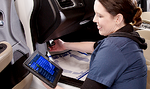 woman using a tablet to help her diagnose car trouble
