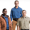 Three Men Wearing Carhartt Rental Workwear