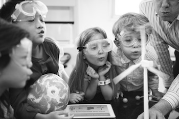 Children watching an experiment in science class